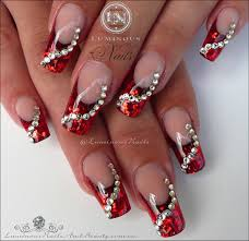 luminous nails glittery red christmas nails with swarovski crystals
