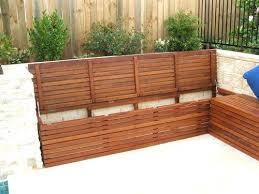 white storage bench with seat pad and wicker baskets outdoor