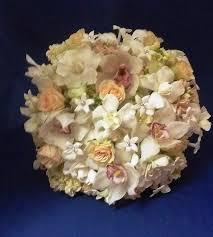 white bouquet gardenia hydrangea orchid rose stephanotis wedding