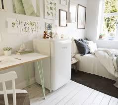 Home Interior Work Home Design White Shiny Mini Fridge Near Bed And Small Workspace