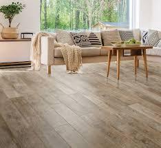 is vinyl flooring better than laminate select surfaces laminate and vinyl flooring