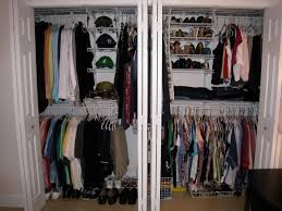 white closet inside white wall with white steel bar and clothes