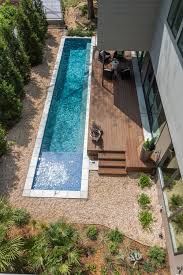 Small Backyard Ideas With Pool Pool With Natural Materials Wood Deck And Pebbles Paisajísmo