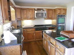 Photos Of Painted Kitchen Cabinets Painted Kitchen Cabinets With Contrasting Island Before 01