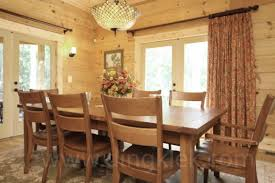 the dining room to ones family has a large table and dining chairs