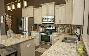 Kitchen Countertops With White Cabinets by Kitchens With White Cabinets And Granite Countertops On 580x386