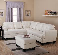 l shaped white leather loveseat and ottoman coffee table with