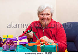 senior citizen gifts senior citizen wrap or unpack gifts closeup stock photo