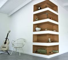 wooden corner bookcase the space between object and sculpture glass shelves and woods