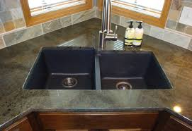 small stainless steel top mount farmhouse kitchen sink on granite