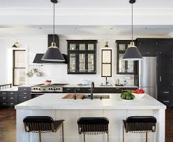 pictures of white kitchen cabinets with black stainless appliances black glass front kitchen cabinets with brass pulls