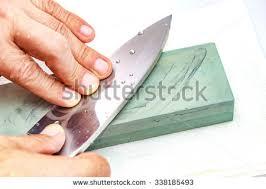 Honing Kitchen Knives Sharpening Stone Stock Images Royalty Free Images U0026 Vectors
