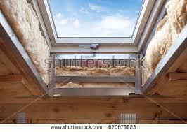 plastic mansard skylight window on attic stock photo 594302828