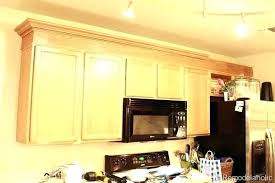 adding crown molding to kitchen cabinets crown molding kitchen cabinets pictures kitchen crown molding