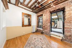 with a cool renovation and a sunroom this tiny east village home