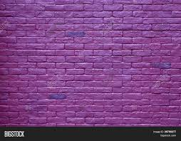 abstract purple rough grunge brick wall background stock photo