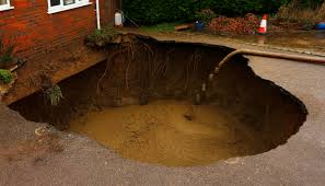 concrete is poured into 4 5 metre wide sinkhole on the driveway of