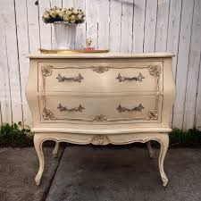 Bombay Chest Nightstand Ideas Bombay Chest Nightstand With Flower Vase And White Wooden Wall
