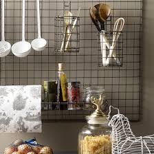 kitchen wall storage ideas turn a metal grate into a pot rack this antique metal rod grate