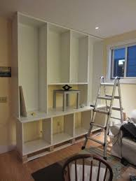 wall of shelves besta built in family room bookshelf and tv unit ikea hackers