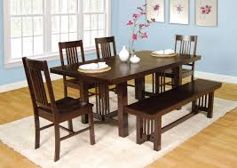 dining room seat dining table wooden vase white black wall