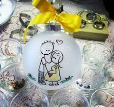 our present pregnancy announcement ornament expecting