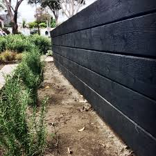 made from japanese charred wood garden wall cj paone aia