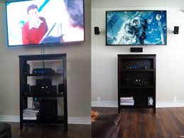 home theater in wall wall mounted some speakers and routed a v cables through the wall