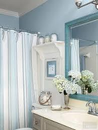 beachy bathroom ideas theme bathroom shower floating shelves shell decor