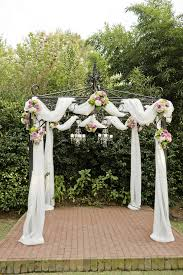 wedding arch gazebo floral filled purple lime and gray garden wedding andie freeman