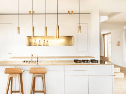 white and gold pendant light white wooden kitchen island gold pendant light gold faucet creative