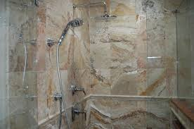 marble wall tile in modern small shower cabin with glass door