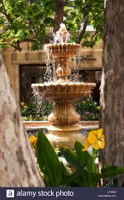 spanish style tiered fountain patio courtyard stock photo royalty