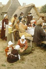 living history reenactment of pilgrims and indians dining on