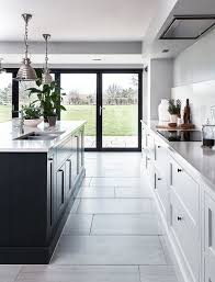 kitchen with black island and white cabinets 25 contrasting kitchen island ideas for a statement digsdigs