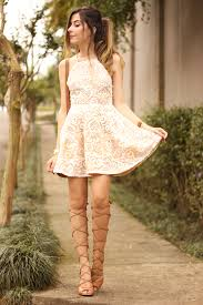girly wearing a gorgeous lace dress in and white with