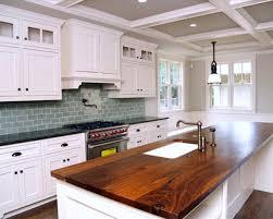 modern white kitchen with pale green subway glass tile kitchen