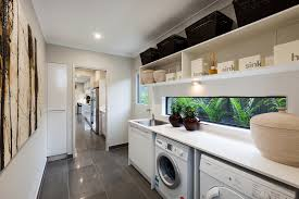 bathroom modern laundry room design with white washing machine