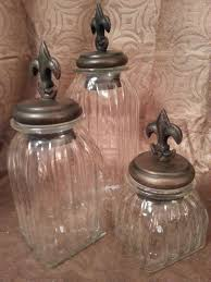 fleur de lis clear glass square canister set decor le fleur fleur de lis clear glass square canister set