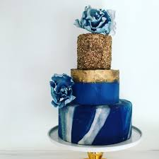 blue and gold wedding cake with gold sequins marbled fondant and