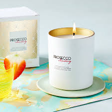 prosecco scented candle with a hint of strawberry by hearth