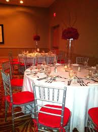 silver chiavari chairs with red seat cushions redwedding