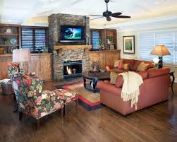 recessed lighting over fireplace fireplace area rug with wood flooring and ceiling lighting also