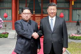 n korea s kim shows unity with china s xi in first foreign trip