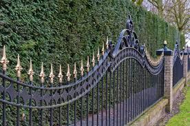 black gold ornamental spiked metal fencing marketing visible
