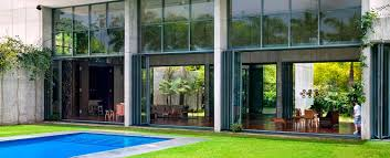 glass wall house airclos bifold doors retractable roof skylights frameless