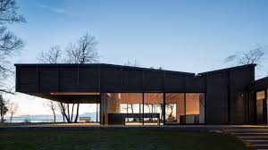 House Features Desai Chia U0027s Michigan Lake House Has A Roof That Cantilevers Over