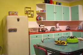 Kitchen With Red Appliances - gorgeous retro kitchen with blue walls and white cabinets with red