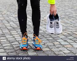 dirty pair used dirty pair of running shoes and new ones stock photo royalty