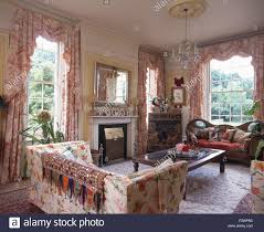 Country Livingroom Indian Throw On A Floral Sofa In A Nineties Country Living Room